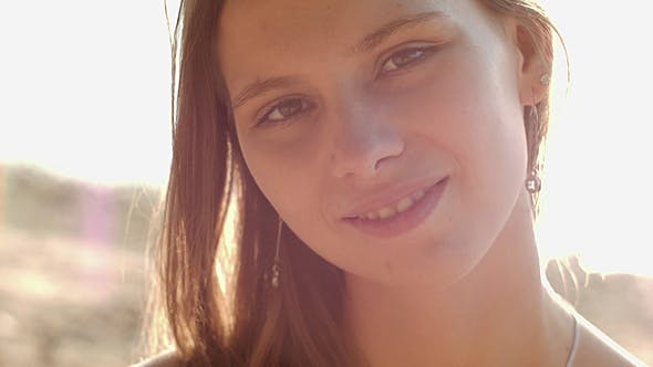 Thumbnail for Girl Smiling To Camera In Sun Rays