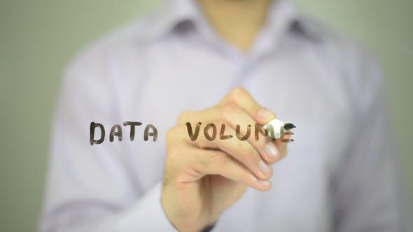 Data Volume, Man Writing on Transparent Screen