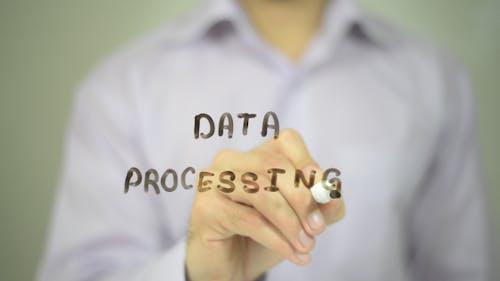 Data Processing, Man Writing on Transparent Screen