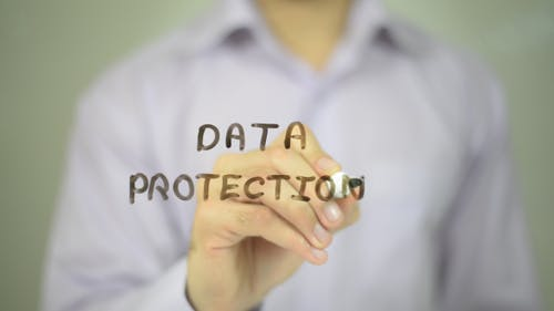 Data Protection, Man Writing on Transparent Screen