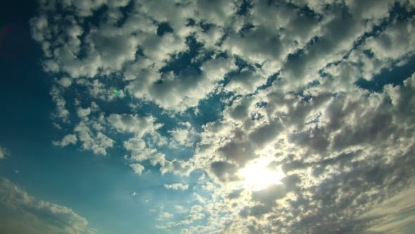 Thumbnail for Clouds Moving In The Sky, The Sun Is Shining Brightly Behind The Clouds.