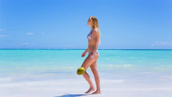 Thumbnail for Woman with coconut on beach