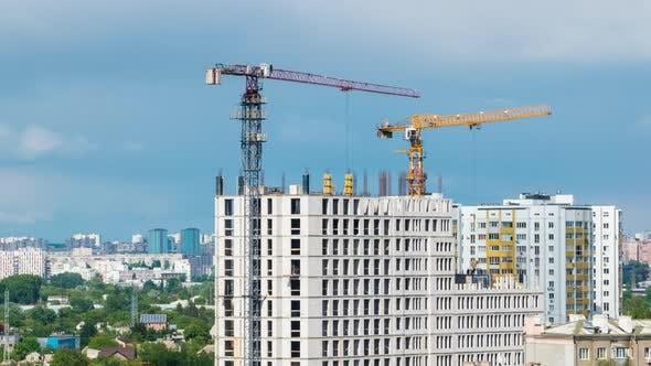 Cityscape Time Lapse, Large Tower Cranes Build Multi-storey Buildings