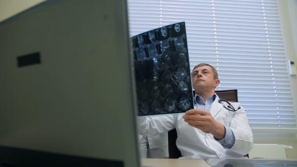 Thumbnail for Doctors Examining An X-ray