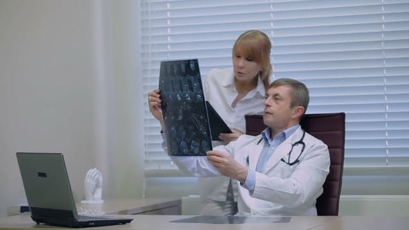 Thumbnail for Doctors Checking Patient's Head Scanning