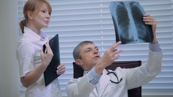 Thumbnail for Two Doctors With X-ray Prints