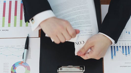 Thumbnail for Businessman Tearing Contract