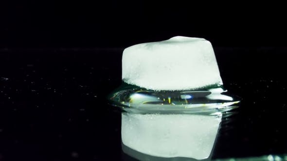 Cover Image for Ice Cube Melting And Moving On a Glass Surface