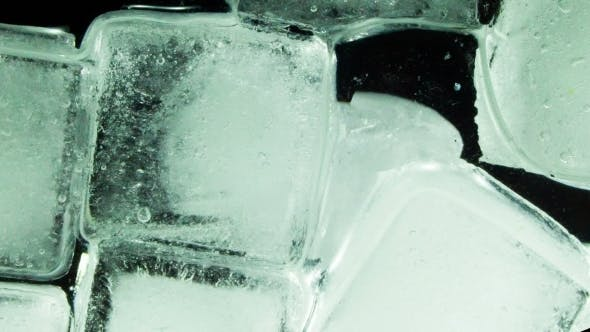Ice Cube Melting And Moving On a Glass Surface