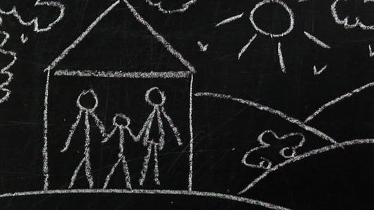 Cover Image for Drawing on A Blackboard Person Drawing a family on The Board.