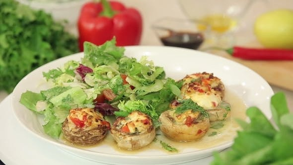 Thumbnail for Stuffed Champignon on White Plate With Salad
