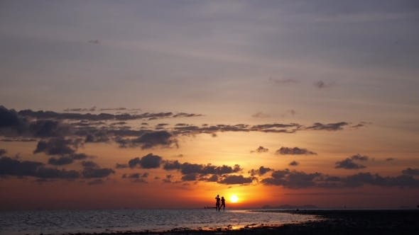 Thumbnail for Silhouette Of Happy Couple On Summer Beach At Sunset