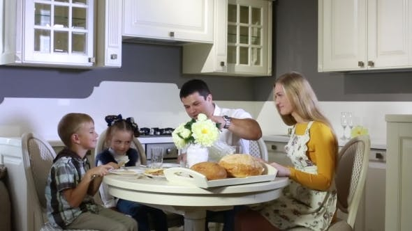 Thumbnail for Family Having Breakfast At The Table