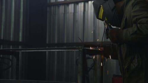 Welder Welding Metal Material In Heavy Industry