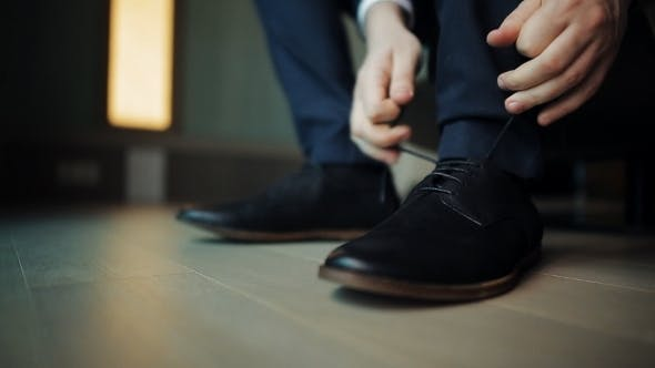 Thumbnail for Groom Tying Shoelaces