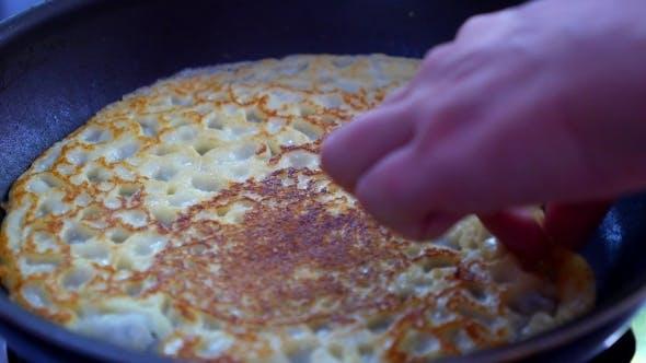 Thumbnail for Making Pancake On Hot Frying Pan.