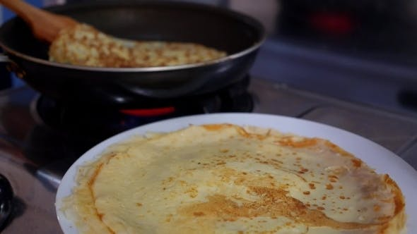 Thumbnail for Making Pancake, Crepes On Frying Pan. Closeup.