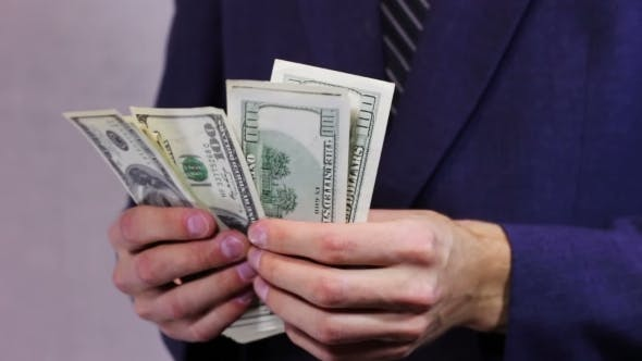 Thumbnail for Businessman Counts Money In Hands