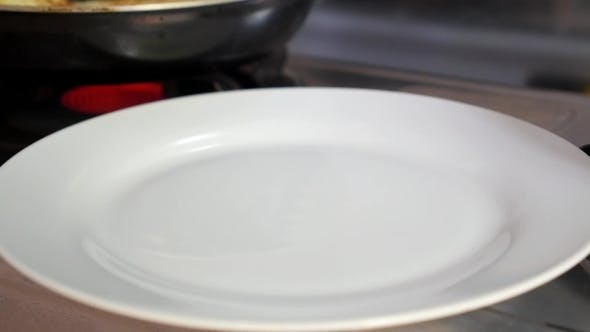 Thumbnail for Fried Pancake On The Plate Near Frying Pan