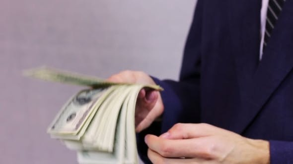 Thumbnail for Businesswomen Counts Money In Hands