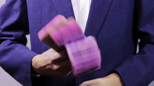 Thumbnail for Businessman With Wads Of Money In Hands.