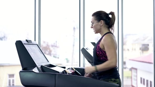 Thumbnail for Young Woman On Treadmill