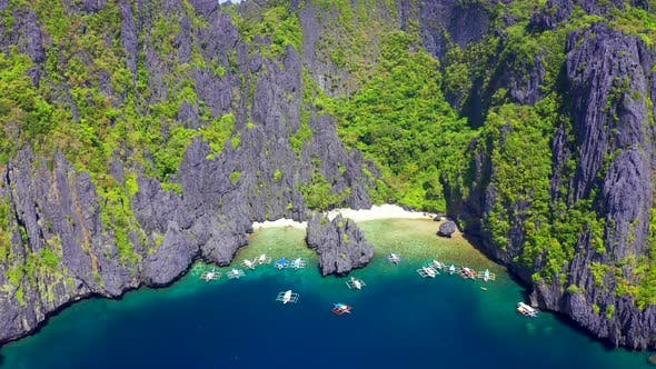 Thumbnail for Beautiful Tropical Island and Secret Paradise Beach Lagoon on Miniloc in the El Nido Archipelago