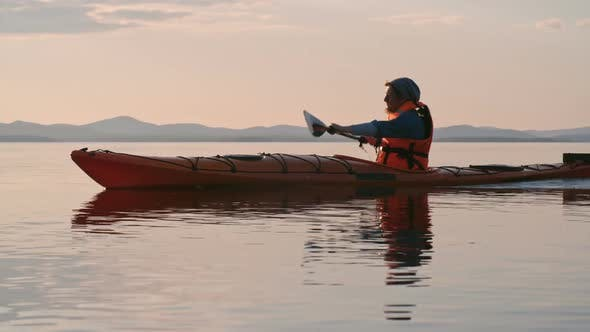 Cover Image for Paddling Kayak at Sunset