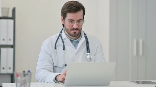 Young Male Doctor Working Laptop