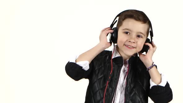 Thumbnail for Young Boy Listens Music on Headphones and Dances, Close Ups