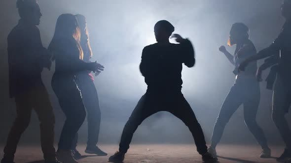 Cover Image for Group of Street Dancers Performing Different Moves on Dark Street