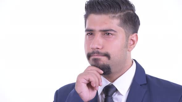 Thumbnail for Face of Happy Bearded Persian Businessman Thinking and Looking Up