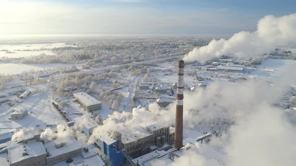 Thumbnail for Smoke Rising from Factory on Cold Winter Day
