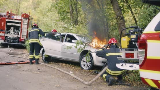 Thumbnail for Firefighters Saving People From Burning Car