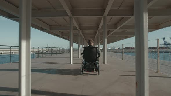 Handicapped Child in Wheelchair on Waterfront