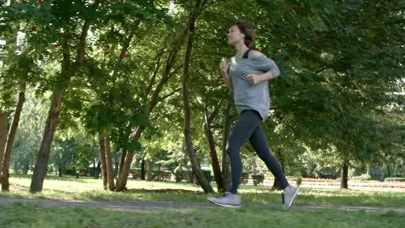 Thumbnail for Healthy Woman Jogging in Park