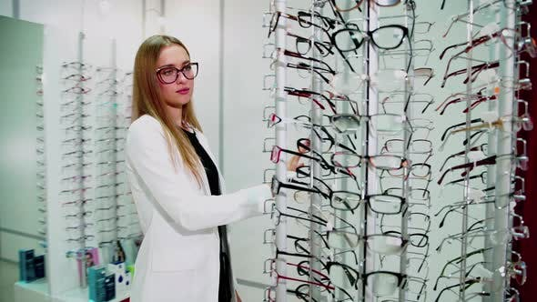 Young Woman Is Choosing a Glasses