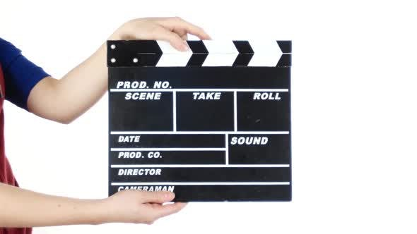 Thumbnail for Girl Uses Movie Production Clapper Board, on White