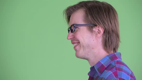 Thumbnail for Closeup Profile View of Happy Young Hipster Man with Eyeglasses Smiling