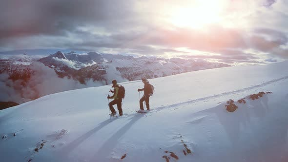 Thumbnail for Two People Hiking in Snow Winter Mountain Landscape