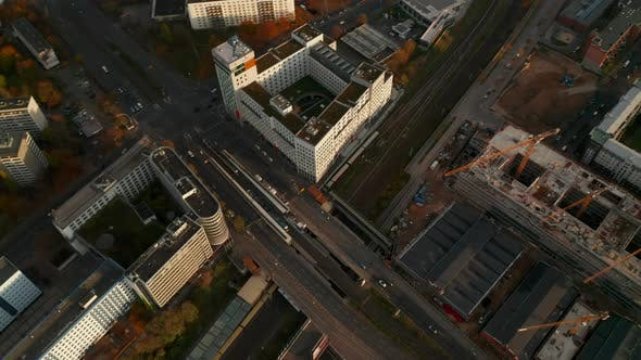 Train Passing Through a Large German City Under Bridge with Car Traffic and Construction Site