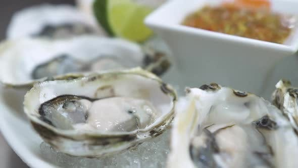 Motion to Dish with Delicious Oysters Sauce and Lime Slices