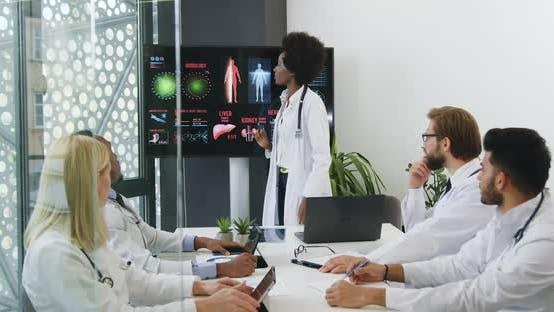Mixed Race Doctors Watching Digital Presentation on Internal Human Organs