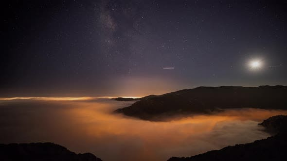 Thumbnail for Night time lapse of a road winding through the mountains in Malibu California