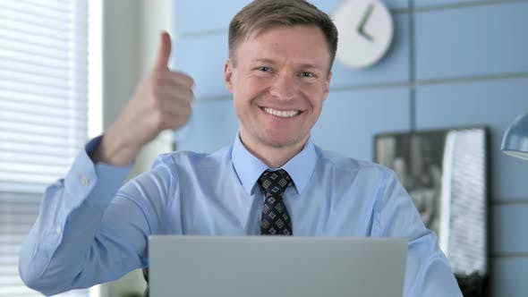 Thumbnail for Thumbs Up By Businessman at Work