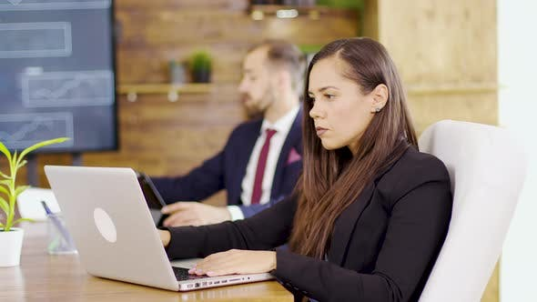 Thumbnail for Young Businesswoman Typing on Computer in the Conference Room