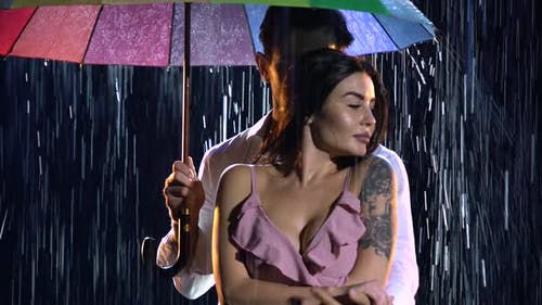 Love Story of a Couple in the Rain Expressed in a Passionate Dance. A Romantic Meeting of Two Lovers