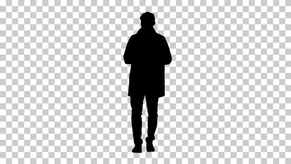 Thumbnail for Silhouette Young man wearing trench coat talking to camera