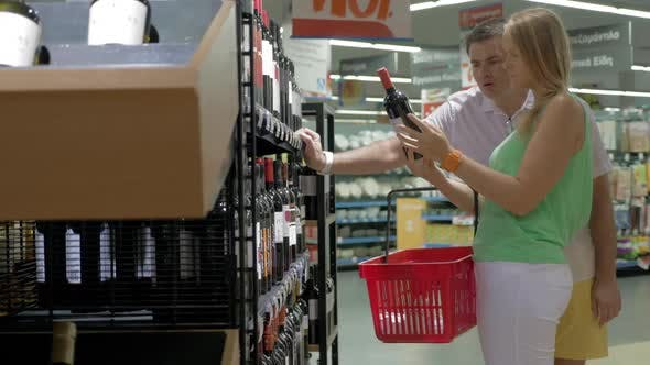 Thumbnail for Family Couple Buying Wine in Supermarket