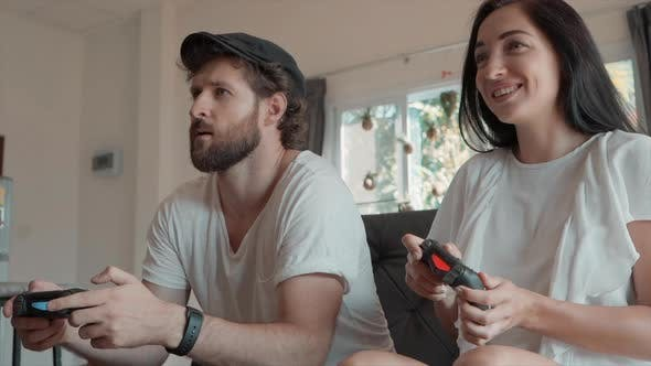 Thumbnail for Man and Woman Playing Video Games and Sitting on Couch